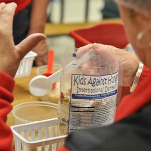 Packaging a Meal | Meals of Hope Marco Island - Meal Packing to End Hunger