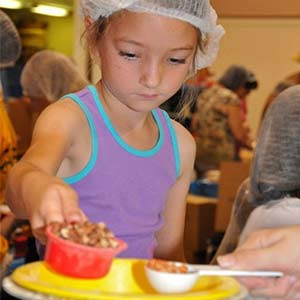 Child Volunteering | Meals of Hope Marco Island - Meal Packing to End Hunger
