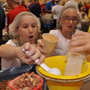 Two Girls Volunteering | Meals of Hope Marco Island - Meal Packing to End Hunger