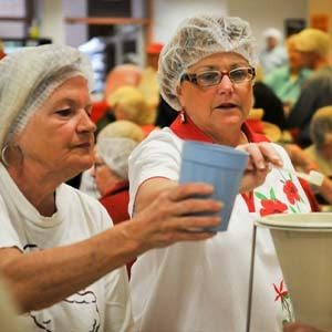 Two Women Volunteering | Meals of Hope Marco Island - Meal Packing to End Hunger