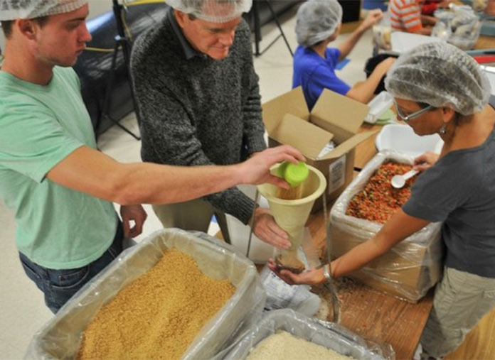 Volunteers Measuring Food | Meals of Hope Marco Island - Meal Packing to End Hunger